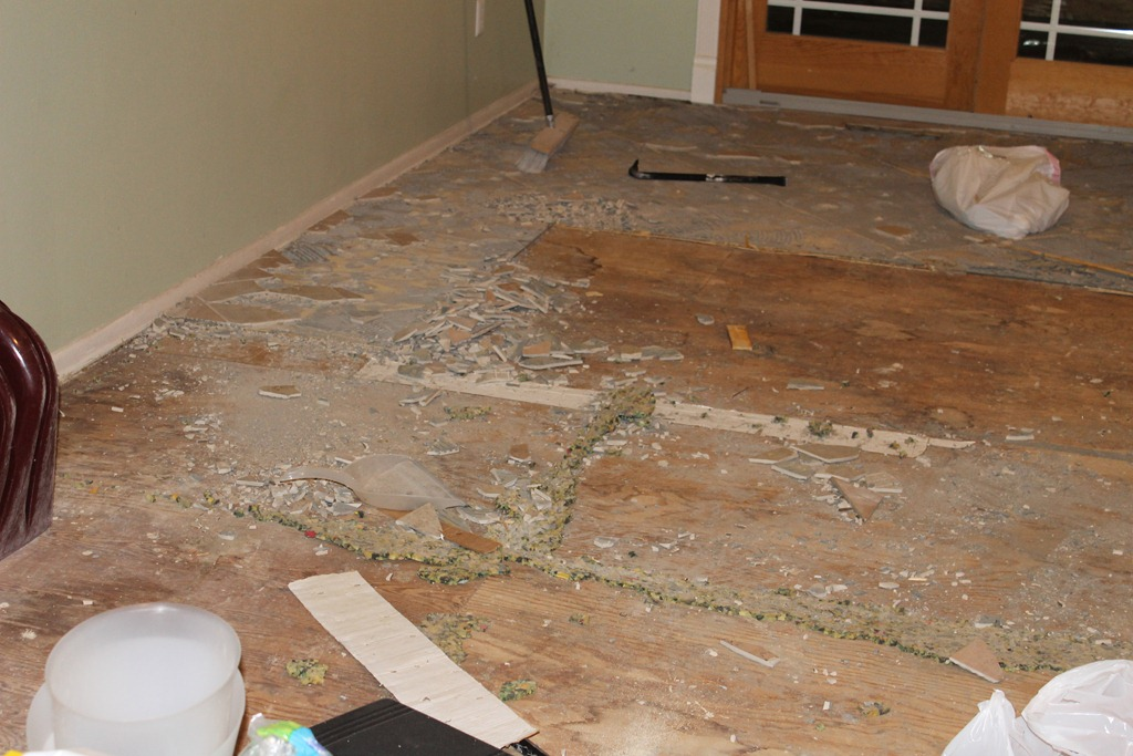 ripped up a ceramic tile floor we will replace it with wood laminate. Black Bedroom Furniture Sets. Home Design Ideas